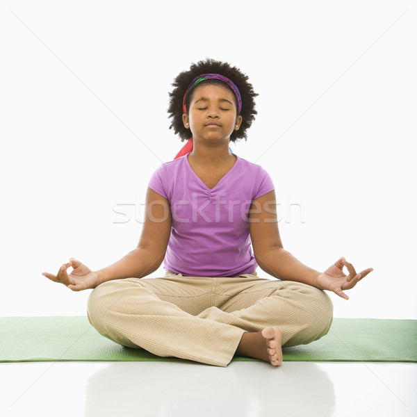 Girl meditating. Stock photo © iofoto