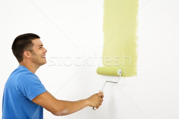 Сток-фото: улыбаясь · человека · Живопись · привлекательный · белый · стены
