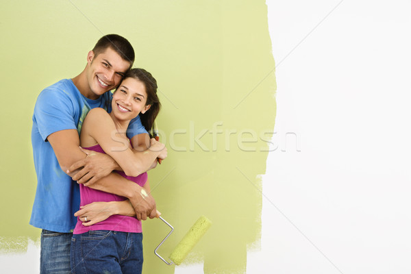 Smiling couple painting. Stock photo © iofoto