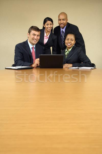Foto stock: Oficina · alrededor · ordenador · portátil · sonriendo
