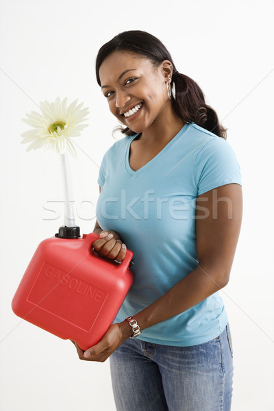 Woman with gas can. Stock photo © iofoto