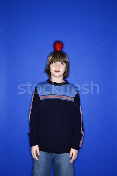Boy with apple on head. Stock photo © iofoto