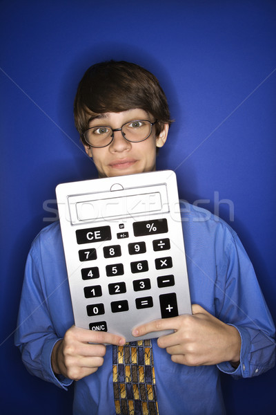 Boy holding oversized calculator. Stock photo © iofoto