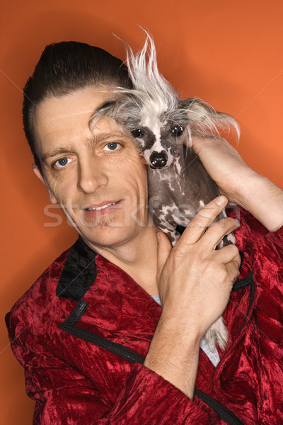 Man holding Chinese Crested dog. Stock photo © iofoto