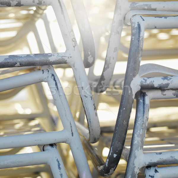 Stacked chairs. Stock photo © iofoto