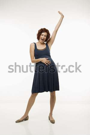 Happy pregnant woman. Stock photo © iofoto