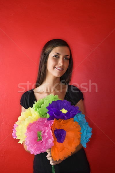 Young Woman Holding Paper Flowers. Isolated Stock photo © iofoto