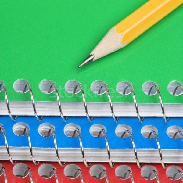 Pencil on notebooks Stock photo © iofoto