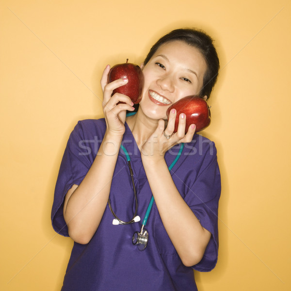 Stock photo: Doctor and apples.
