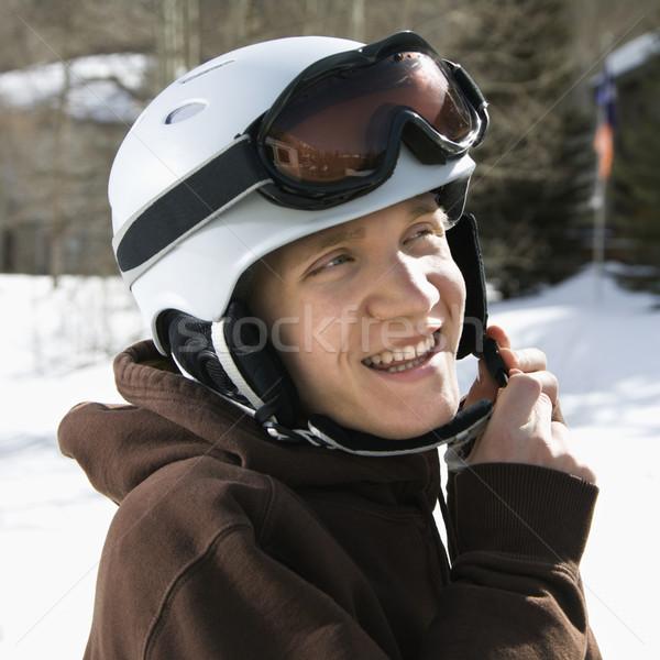 Teenager fastening helmet. Stock photo © iofoto