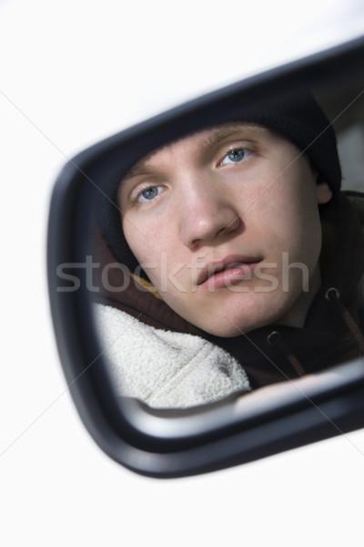 Teen in side view mirror. Stock photo © iofoto