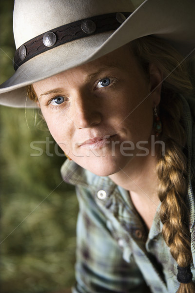 Attractive Young Woman Wearing a Cowboy Hat Stock photo © iofoto