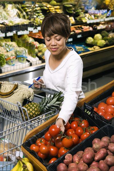 Kobieta spożywczy zakupy w średnim wieku Zdjęcia stock © iofoto