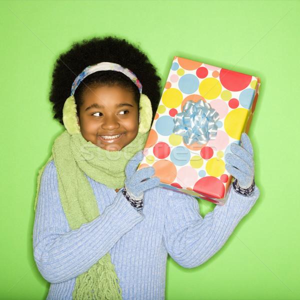 Girl with gift. Stock photo © iofoto