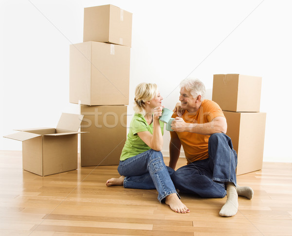 Couple with moving boxes. Stock photo © iofoto