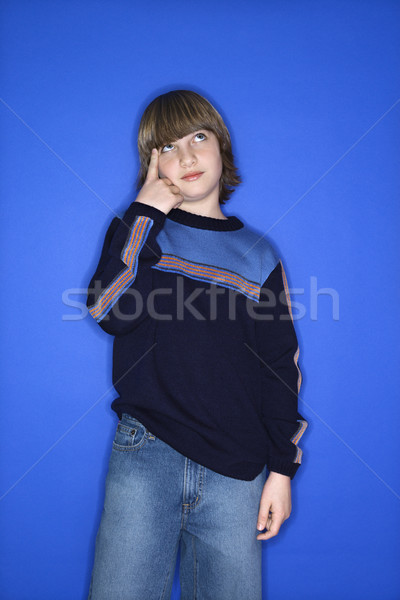 Boy pointing to head. Stock photo © iofoto