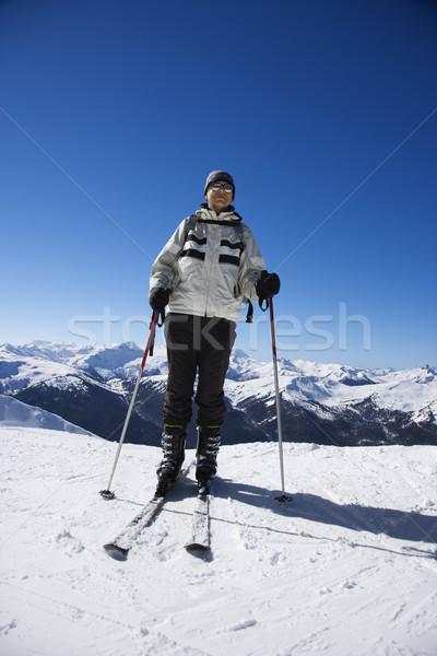 Man on ski slopes. Stock photo © iofoto
