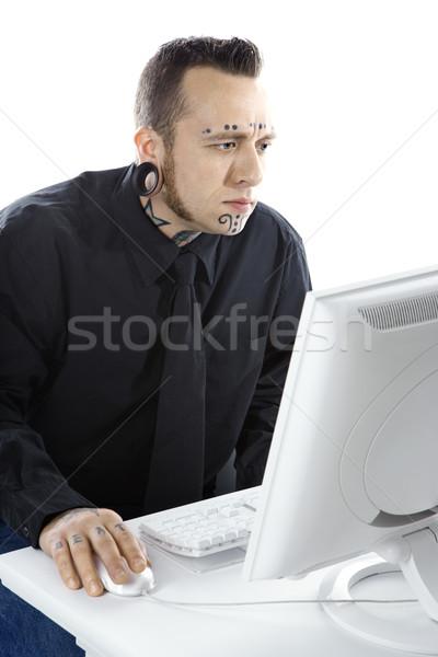 Tattooed man on computer. Stock photo © iofoto