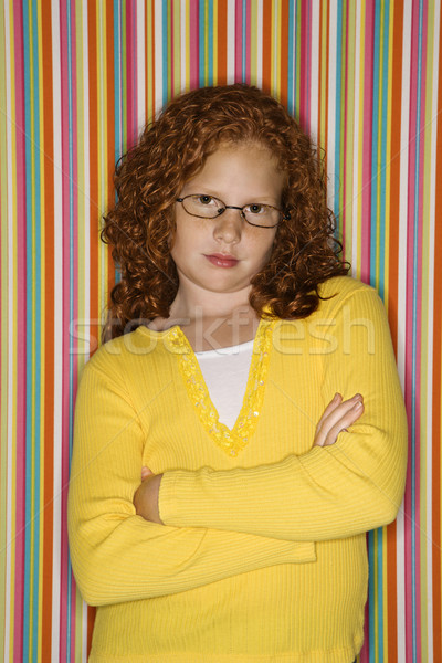 Girl with arms crossed. Stock photo © iofoto