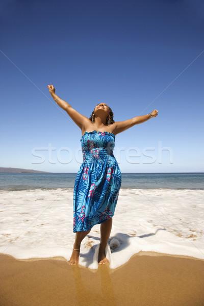 Young woman on beach. Stock photo © iofoto