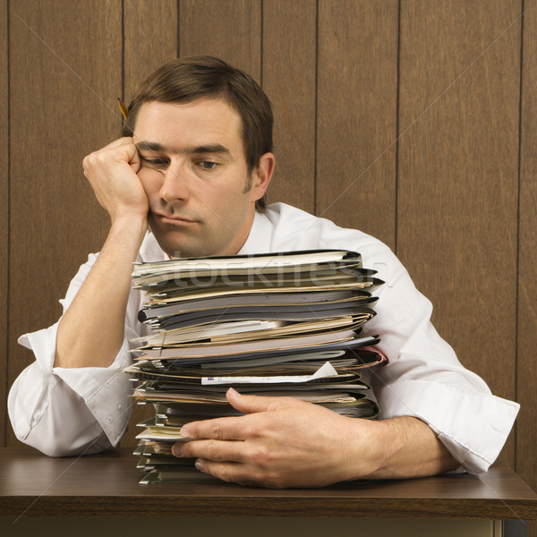 Overworked businessman. Stock photo © iofoto