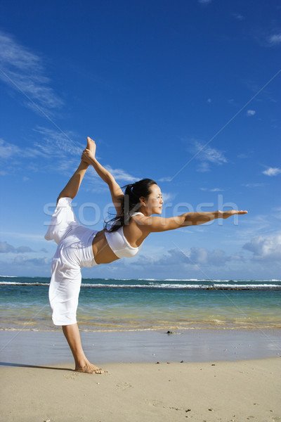 Woman Doing Yoga on Beach Stock photo © iofoto