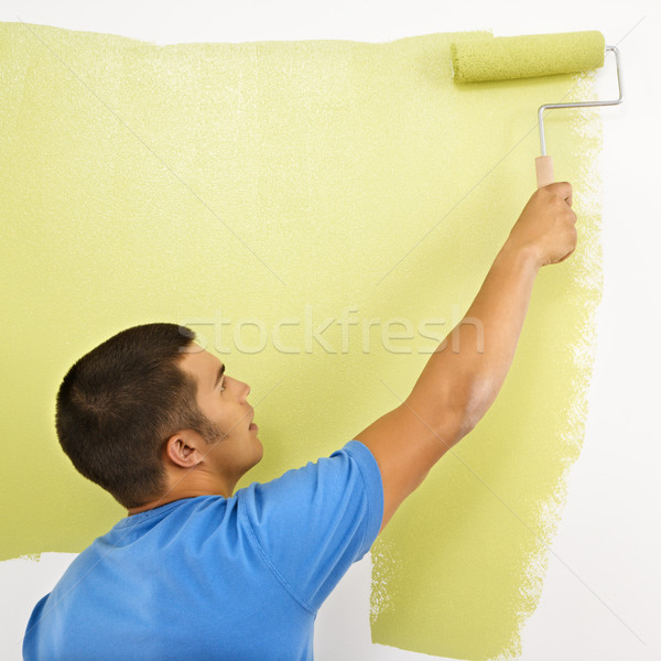 Stock photo: Man painting wall.