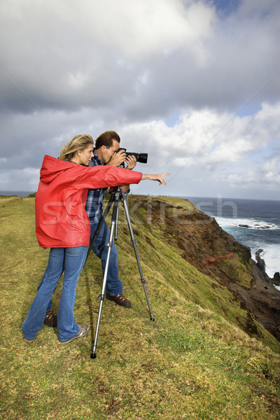 Couple taking pictures. Stock photo © iofoto