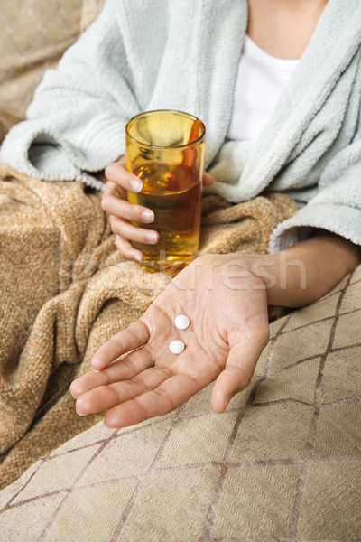 Woman taking pills. Stock photo © iofoto