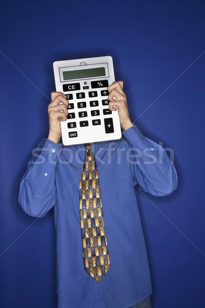 Boy holding calculator. Stock photo © iofoto