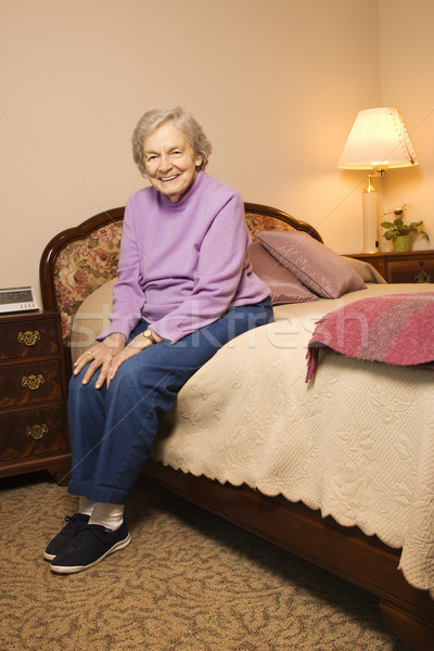 Mature woman on bed. Stock photo © iofoto