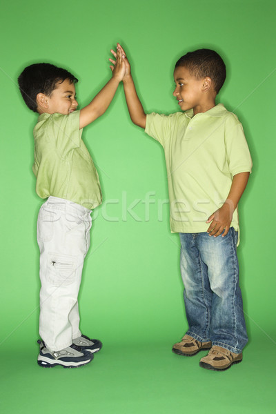 Boys giving high five. Stock photo © iofoto
