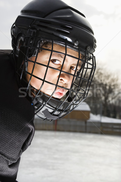 Stock photo: Ice hockey player boy.