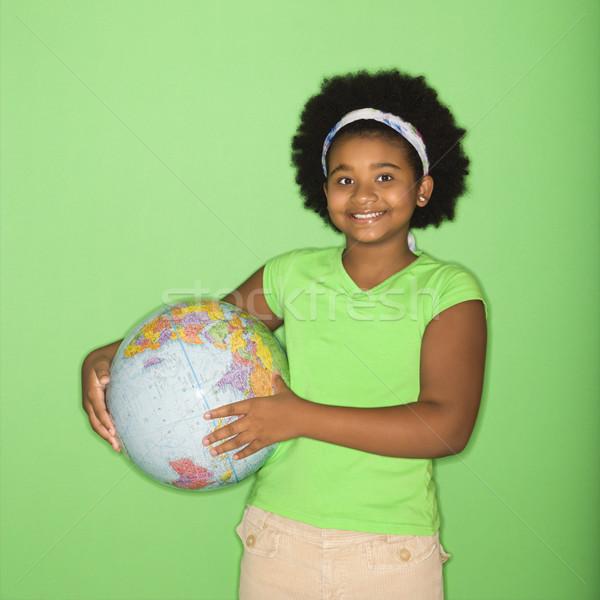 Girl holding globe. Stock photo © iofoto