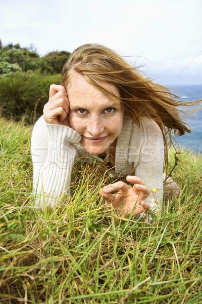 Woman lying in grass. Stock photo © iofoto