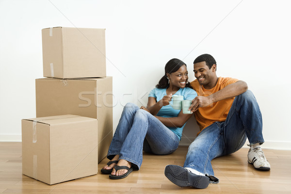 Portrait of couple with boxes. Stock photo © iofoto