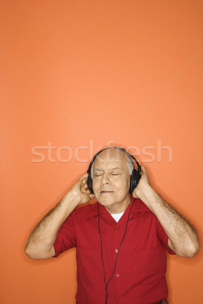 Man listening to music. Stock photo © iofoto