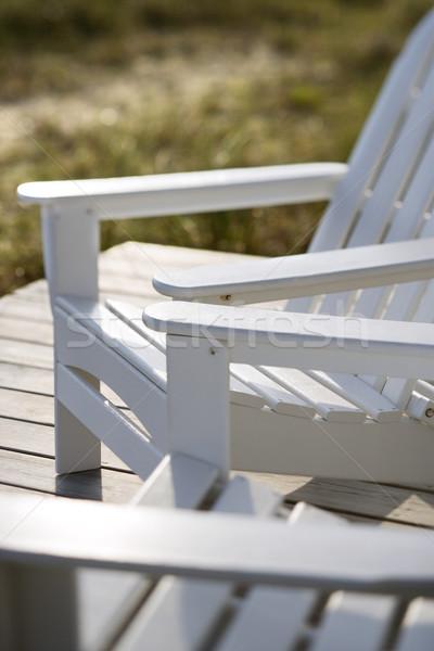 Adirondack chairs at beach. Stock photo © iofoto