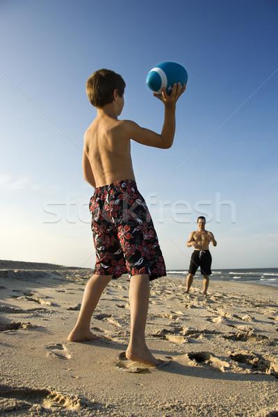 Boy throwing football with dad. Stock photo © iofoto