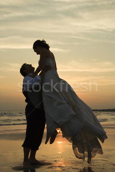 Groom lifting bride up. Stock photo © iofoto