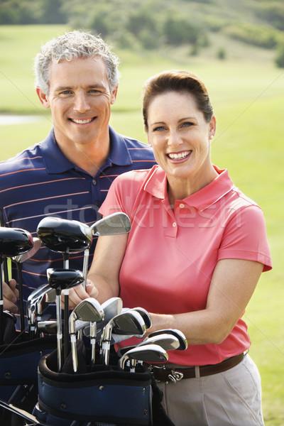 Para golf człowiek kobieta kluby golfowe uśmiechnięty Zdjęcia stock © iofoto