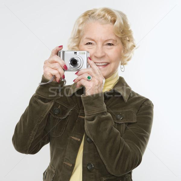 Donna fotocamera digitale senior foto Foto d'archivio © iofoto