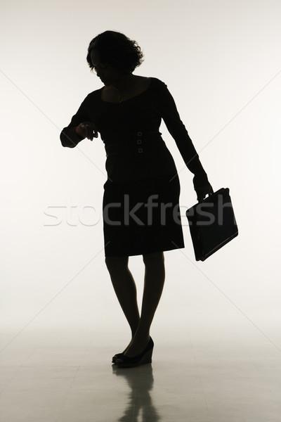 Businesswoman checking time. Stock photo © iofoto