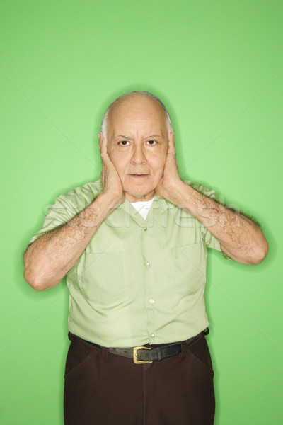 Man with hands over ears. Stock photo © iofoto
