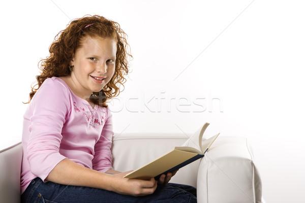 Girls sitting reading book. Stock photo © iofoto