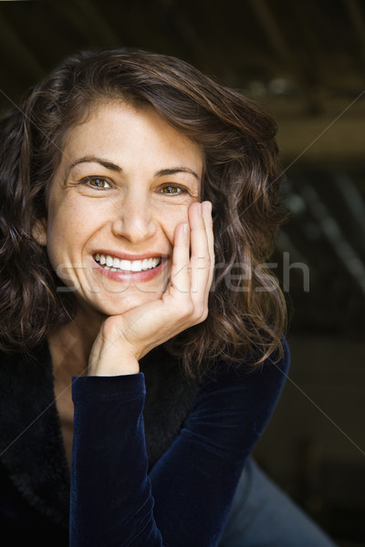 Pretty woman smiling. Stock photo © iofoto