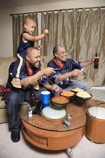 Family watching tv. Stock photo © iofoto