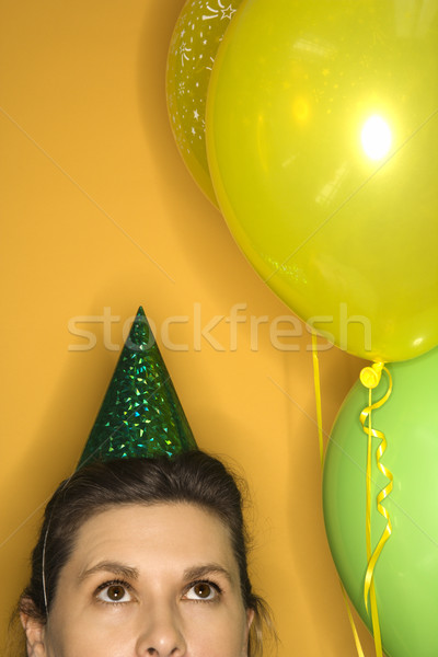 Woman wearing party hat. Stock photo © iofoto