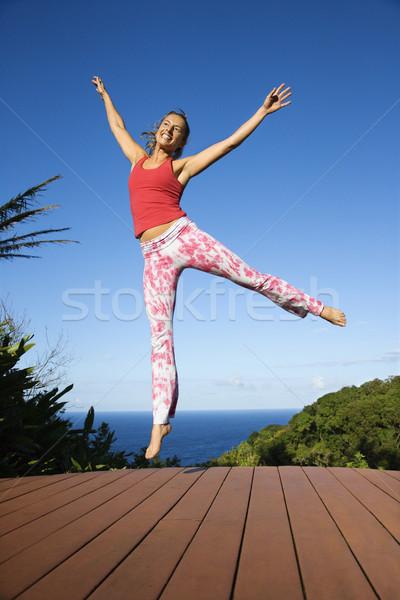 Woman jumping into air. Stock photo © iofoto