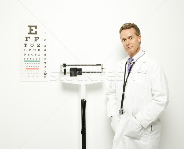 Stock photo: Doctor with scale.